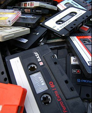 A heap of old and unwanted cassette tapes.