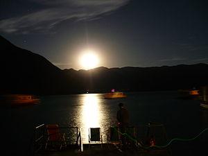 Moon shining over Cabra Corral dam
